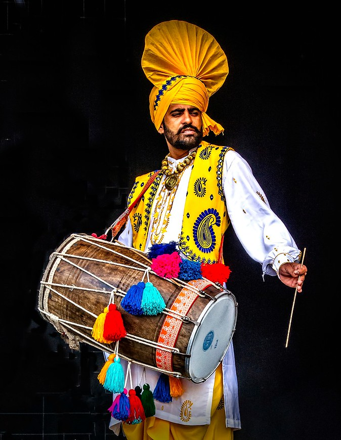 Dramatic Divali Drummer with Yellow headtop